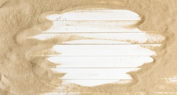 Sand on a  white planked wood. Summer background. Flat lay, top view, copy space