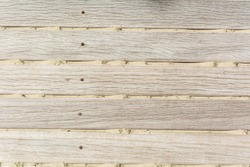 Sand on planked wood. Summer background with copy space. Top view. Close up shot of a wooden beach path texture with some sand