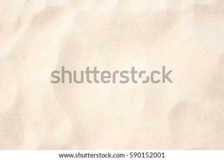 Sand on the beach as background - Shutterstock ID 590152001