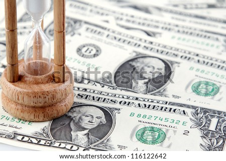 Sand passing through timer on American banknotes