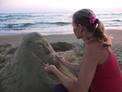 sand sculpture and the sculptor
