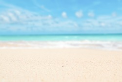 Sand, sky, sea summer concept with defocused background