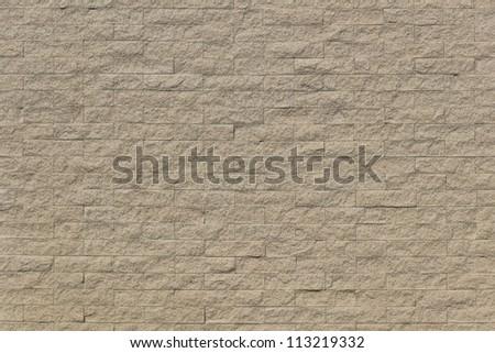 Sand stone bricks pattern on sunny day. - stock photo