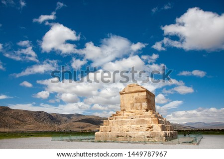 Sand stone large tomb of Cyrus the Great under a sunny clear sky in Pasargadae, Iran, showing the greatness old time of Persian empire