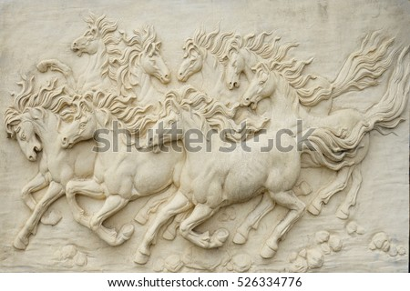 Stock Photo Sand stone sculpture brick wall of herd horse run background, low key black and white, high contrast and hard lighting tone