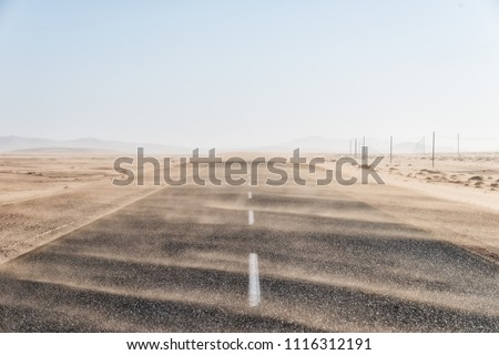 Sand Storm Across Lonely Desert Road in Southern Namibia taken in January 2018