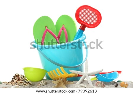 Sand toys with shells on white background,summer holiday concept.