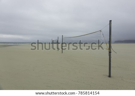 Sand volleyball court on the beach. Cloudy sky #785814154