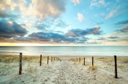 sand way to the North sea beach and beautiful sky, Holland