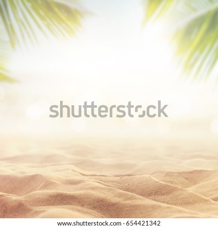 Sand with blurred Palm and tropical beach bokeh background, Summer vacation and travel concept. Copy space - Shutterstock ID 654421342