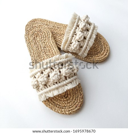 Photo of  Sandal natural straw shoes isolated woven product macrame work, shoes pack shot, macrame sandals in white background, Bali beach summer traditional craft diy hobby ethnic boho chic Morocco style shoes