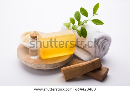 Sandalwood/Chandan Handmade Bath Soap. Placed with Oil, Ubtan, Sticks and Towel, selective focus