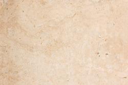 Sanded texture of light beige granite