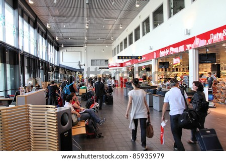 SANDEFJORD, NORWAY - AUGUST 22: Travelers on August 22, 2010 at Sandefjord Airport, Norway. Sandefjord (also known as Torp) is the 7th busiest airport in Norway with 1.6m pax in 2010.