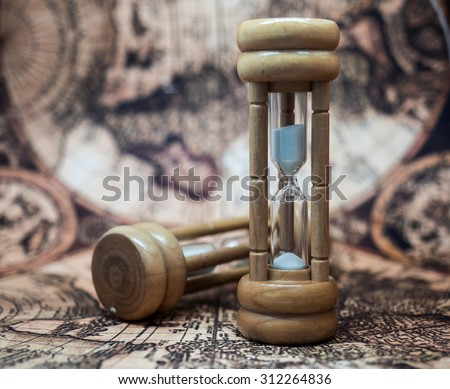 Sandglass, Hourglass, Sand Timer, Sand Clock on Antique World Map Background.