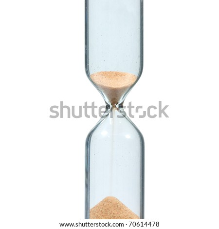 Sandglass with running sand isolated on white