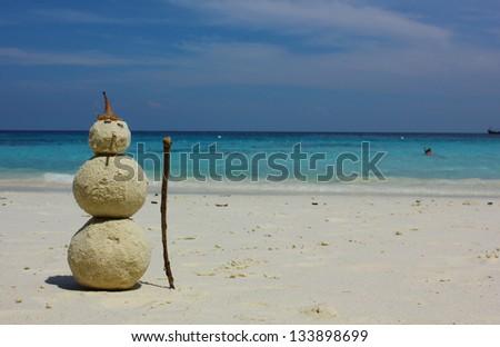Sandman with blue sea background