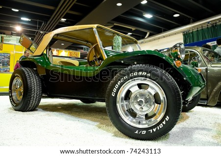 SANDOWN PARK, UK - MARCH 26: A custom built Dune Buggy on display at the Volksworld VW vehicle show. Volksworld Show, Sandown Park, UK. March 26, 2011.