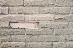 sandstone brick walls that are peel off because of long time and not work standard construction.