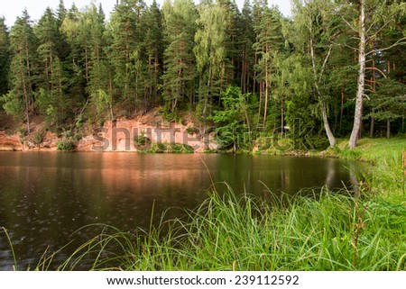 sandstone cliffs on the river shore in the Gaujas National Park, Latvia Stok fotoğraf ©