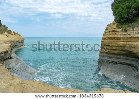 Photo of  Sandstone cliffs with beautiful turquoise waters of the Mediterranean in Canal d'Amour on Corfu island, Greece