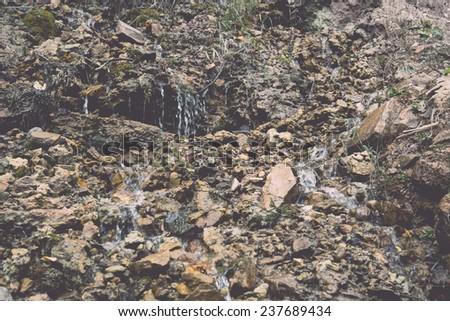 sandstone cliffs with water...