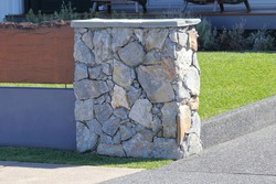 Sandstone drive way pillar in front of a house