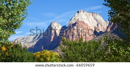 Sandstone peaks framed by early fall foliage in Zion Canyon National Park, Utah.