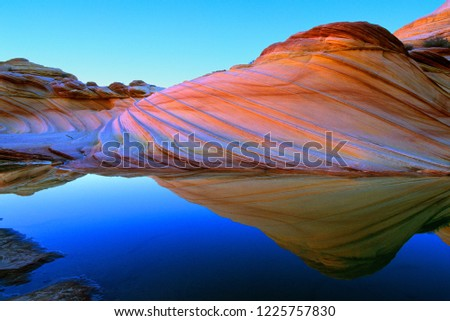 Sandstone Prism 4 (variation).  Water and quartz in rock bend light to create colors of rainbow.  Vermilion Cliffs National Monument.  Arizona, Utah border.  U.S.A.