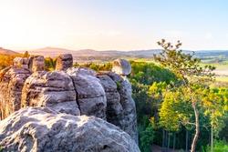 Sandstone rock town near Hruba Skala. Jested Mountain on background. Spring landscape of Bohemian Paradise, Czech: Cesky Raj. Czech Republic.