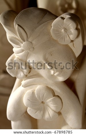 sandstone statue of woman, Bali architecture