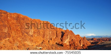 Sandstone wall in Valley of Fire State Park, Nevada, glowing under the setting sun.