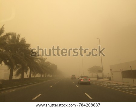 Sandstorm blowing dust across a busy highway in Dubai, United Arab Emirates