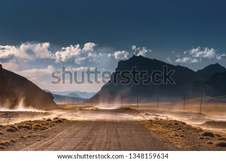 Sandstorm. Dust storm in the mountains. Mountain Landscape.