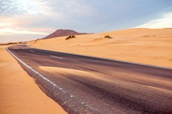 Sandstorm on the desert road on Corralejo dunes on Fuerteventura island in Spain