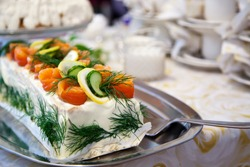 Sandwich cake with salmon, lemon and cucumber