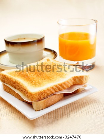 Sandwich, cup of coffee and fresh squeezed orange juice for breakfast. Shallow DOF