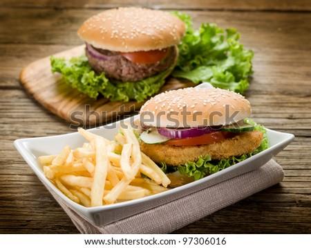 sandwich hamburger with chicken  potatoes and salad