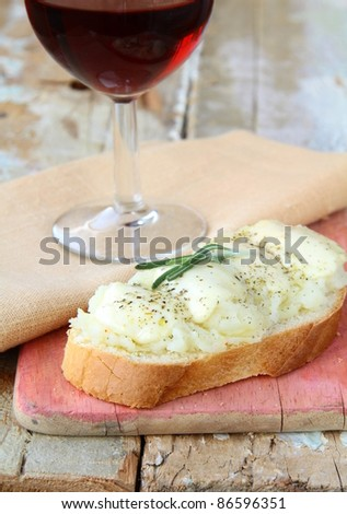 sandwich of white bread with mozzarella cheese and a glass of wine