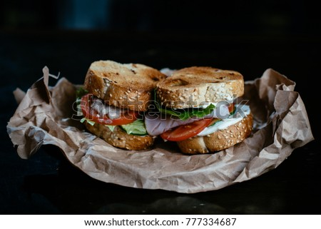 Sandwich on craft papper with black background