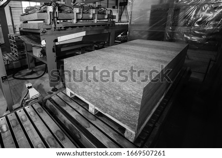 Sandwich panel production at the factory. Panel Stacking