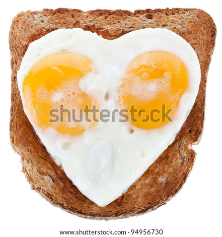 sandwich piece of bread toast cut in shape of heart with egg Isolated on white background