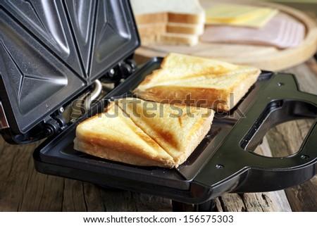 Sandwich toaster with toast closeup Stock photo ©