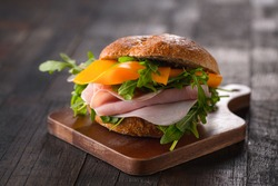 sandwich with cheese, ham and arugula
