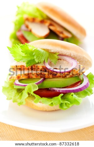 sandwich with chicken,avocado and tomato