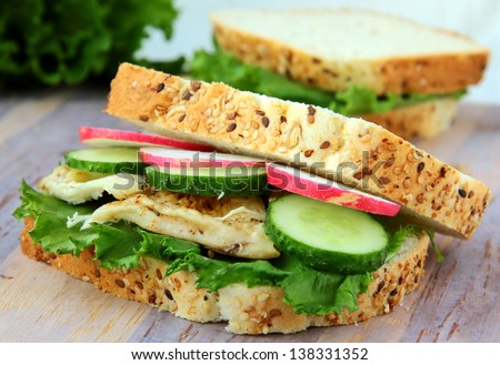 sandwich with fresh vegetables and cold chicken