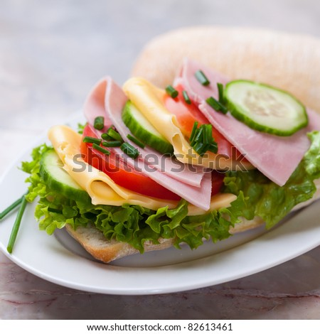 Sandwich with fresh vegetables, cheese and ham