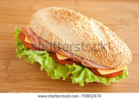sandwich with ham and cheese on wood