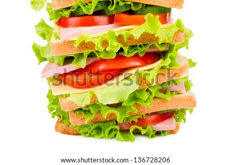 Sandwich with ham,cheese and fresh vegetables isolated on white background