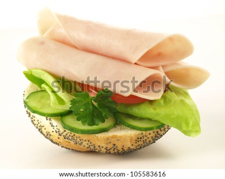 Sandwich with ham, lettuce, tomato and cucumber